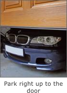 Picture showing BMW in garage parked close up to opening garage door