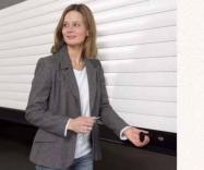 Picture of woman using convenient handles to open or close garage door