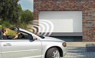 Remotely operated double width garage door